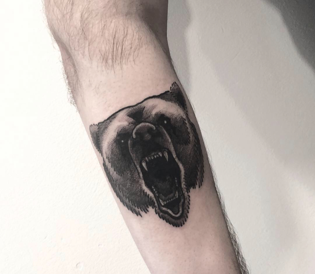 Blackwork bear tattoo