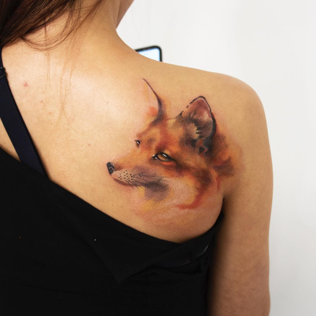 Realistic colour fox tattoo