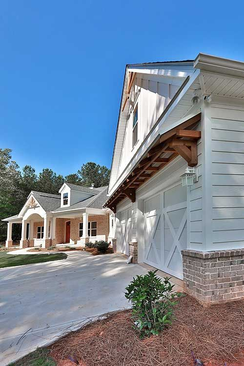 This exterior still offers the appeal of a large porch but without steps into the home.