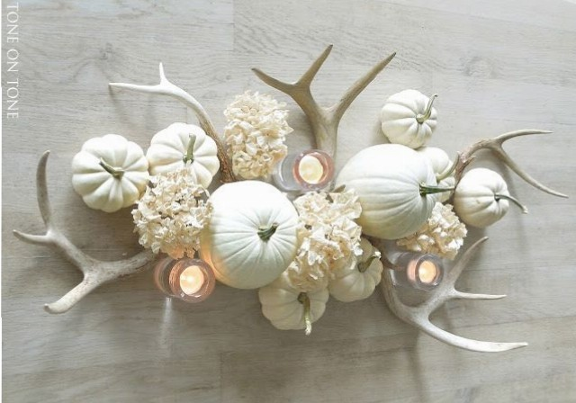 More of a neutral-lover than fall's traditional orange hues? Opt for painted white pumpkins with monochromatic accents.