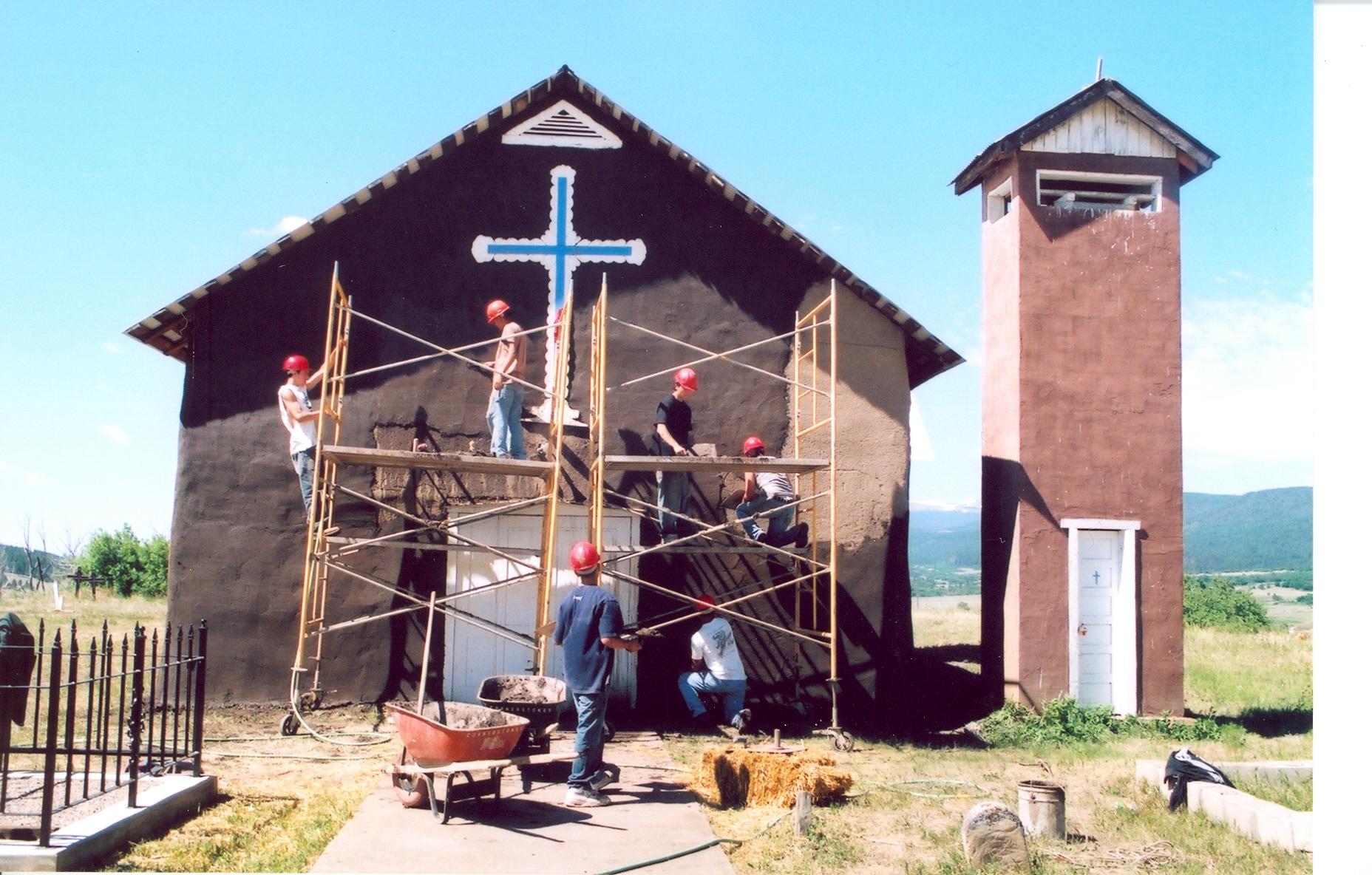 June-Mora-youth-mud-plastering0003.jpg