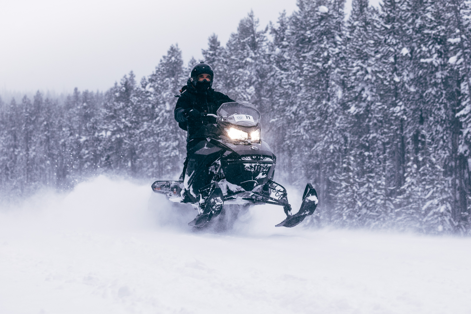 A pair of Ski-Doo Summit 850 Snowmobiles were our tools of choice for multiple feet of fresh powder in the morning and insane blizzard conditions in the afternoon.