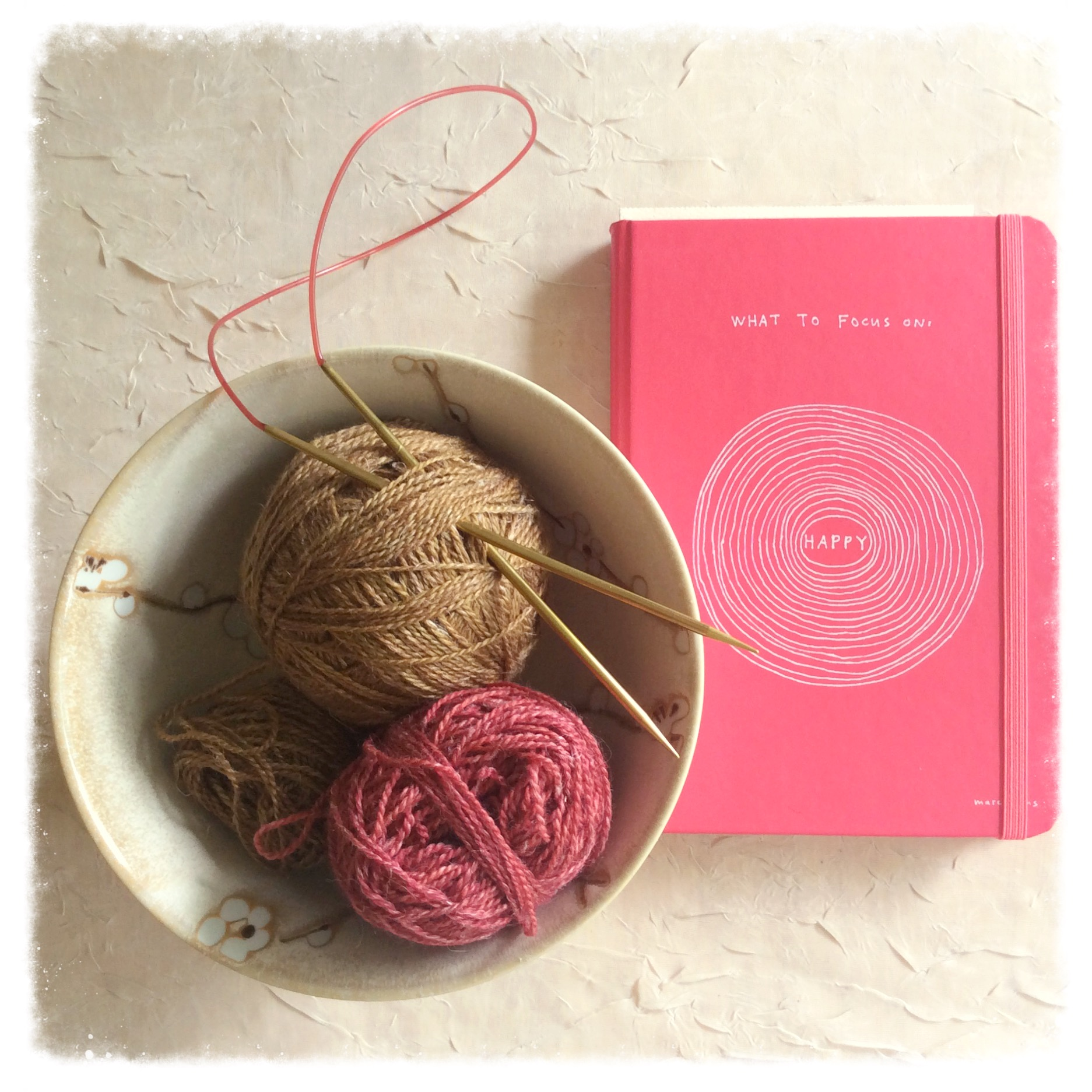 Lots of planning + lots of yarn = new designs for you! Shown here: My Blue Peninsula planning/task journal (by  Peter Pauper Press ) and Fibre Co. Meadow, left over from my  Calliopsis Cowl .