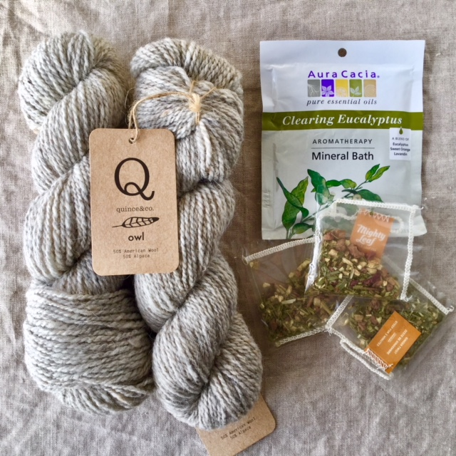 Two skeins of Quince & Co.  Owl  in Abyssinian, Aura Cacia Clearing Eucalyptus Aromatherapy Mineral Bath, and Mighty Leaf Ginger Twist Tea
