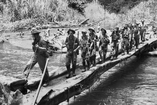 Australian prisoners marching along the Kokoda Track during World War II