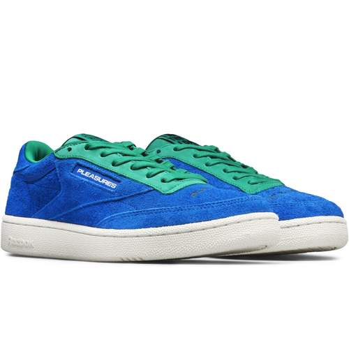 """Reebok - x Pleasures CLUB C 85 / $100""""Reebok and Pleasures capture the mash up spirit that birthed things like rap-metal and rock and jock softball games on MTV, with a new capsule that explores the intersection of light and dark."""""""
