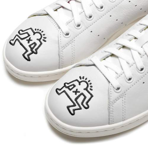 """Adidas - Keith Haring Crystal / $100""""Adidas caps off their Pride Month 2019 celebrations with a capsule pack celebrating the work of legendary artist Keith Haring. Three footwear silhouettes, the Rivalry Hi, Nizza Hi, and Stan Smith, along with three t-shirt colorways feature the signature graffiti style, blocky outline figures, bringing an exuberant, playful, graphic sensibility to these Adidas classics."""""""