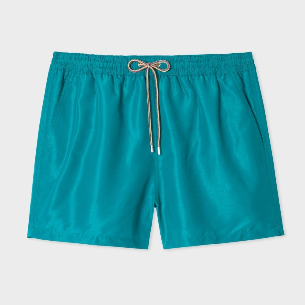 Paul Smith - Men's Petrol Blue Swim Shorts/ $125.00These traditional shorts are given an update with an uncommon blue color and cool sheen.