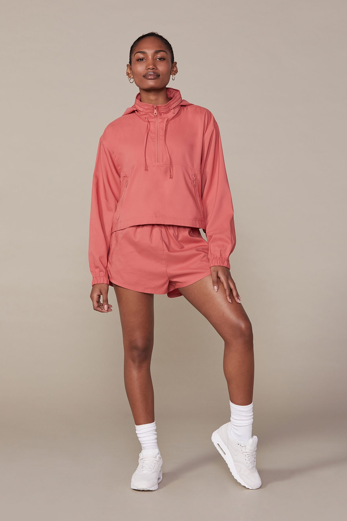 Girlfriend Collective - Clay Hummingbird Half Zip Windbreaker / $118.00Made from 34 plastic water bottles, this windbreaker is not only great for the environment; it's totally adorable to throw on after the gym.