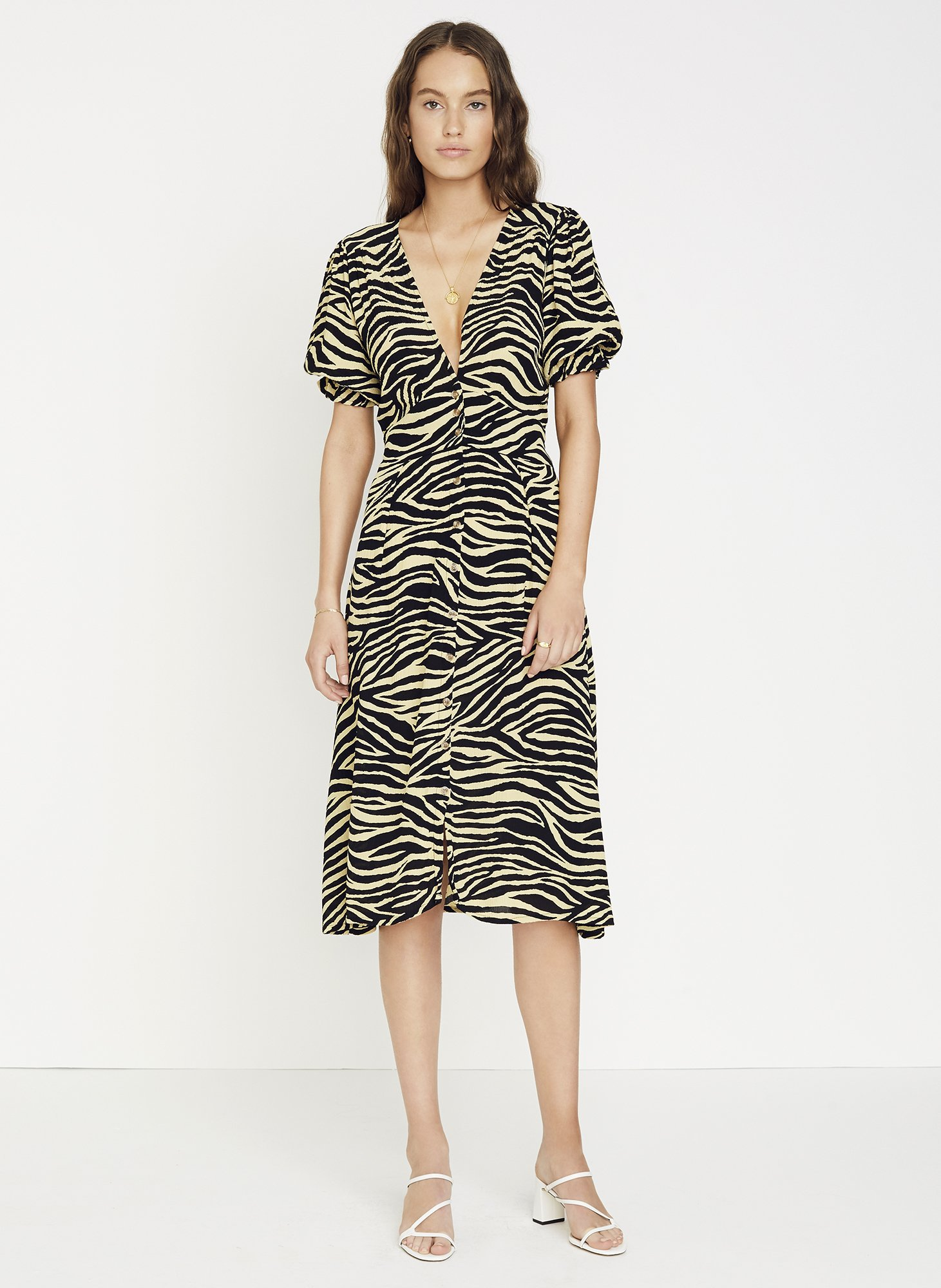 Faithfull the Brand - Amaia Zebra Print – Rafa Midi Dress / $199.00Although Faithfull the Brand is the holy mecca for perfect floral dresses, this zebra print midi stood out as a must-have.