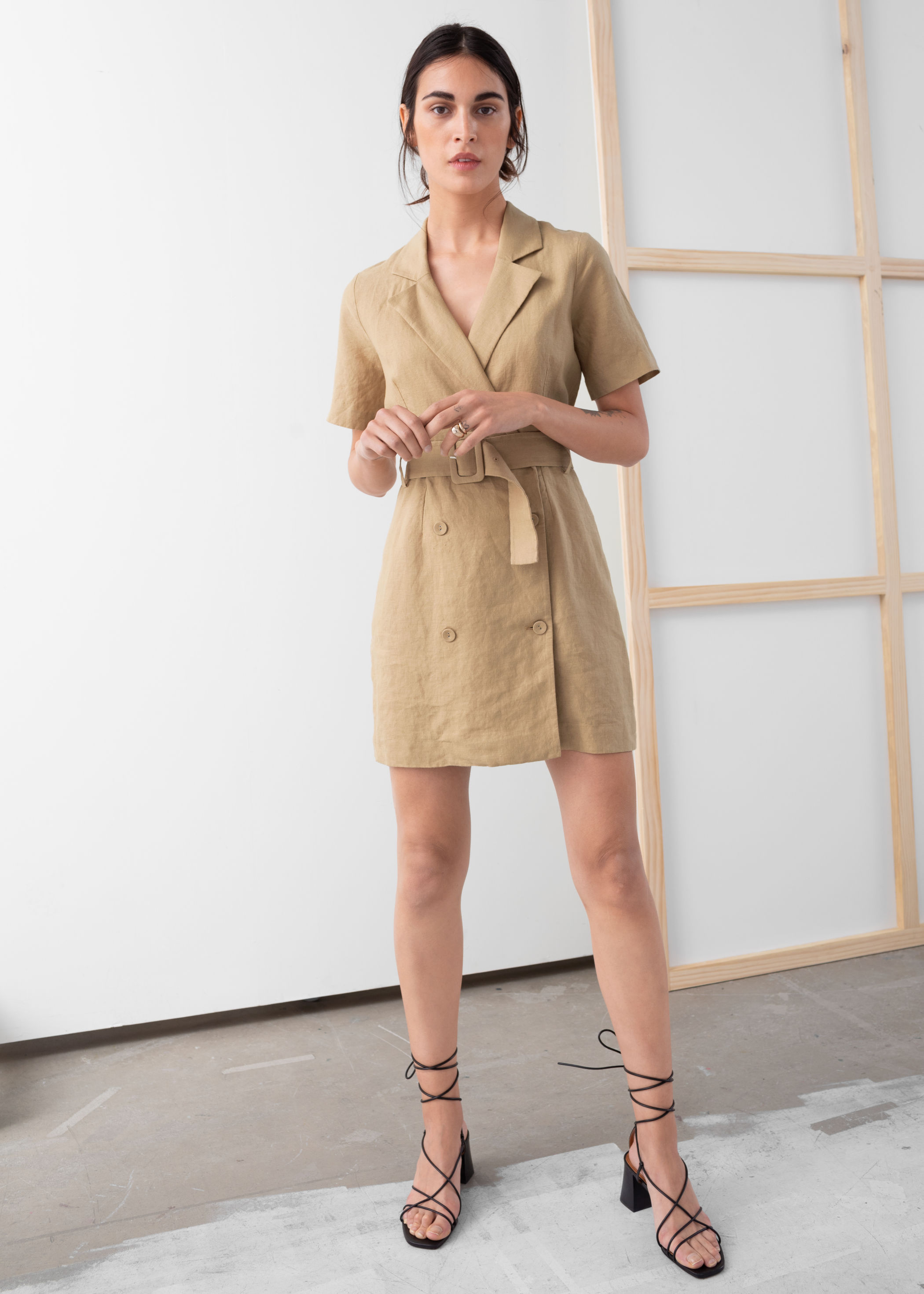 & Other Stories - Belted Linen Trench Mini Dress / $119.00This is the definition of effortless chic. Not only is it on trend, the neutral color and breathable fabric make it easy to wear.
