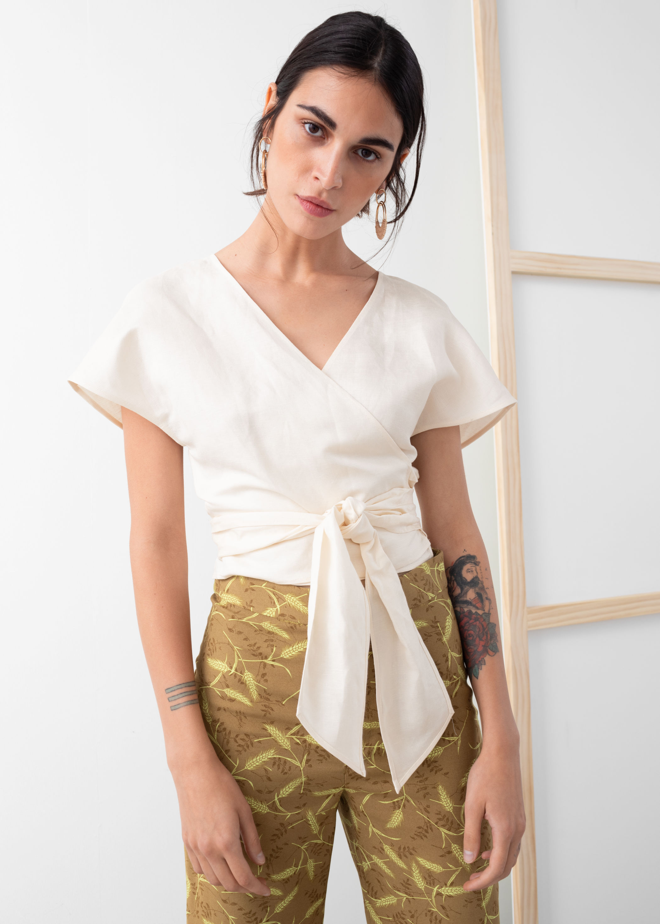 & Other Stories - Linen Blend Wrap Top / $59.00This wrap top is smart both fashion-wise and cool-wise with it's loose fitting sleeves and linen material, coupled with its flattering v-neck and wrap waist.