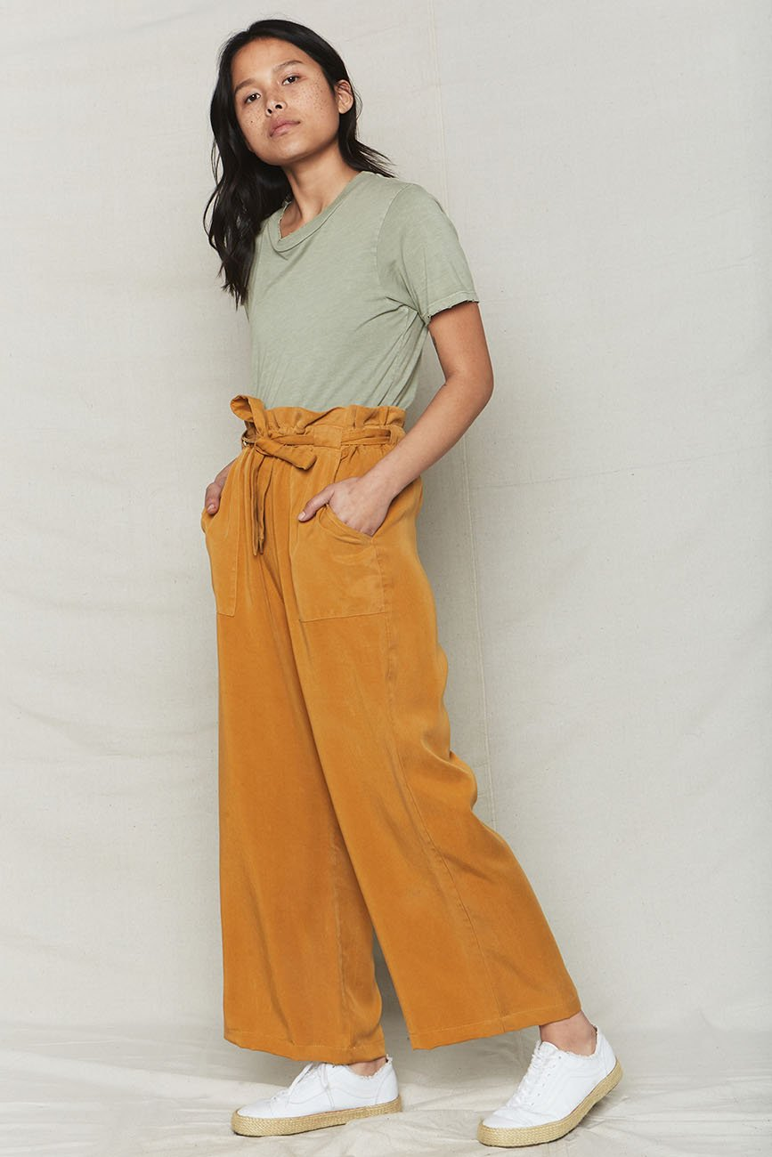 Back Beat Rags - Golden Tencel Paperbag Pants / $105.00These pants are the perfect transition piece to get you from this scorching summer heat to the crisp fall days. Paperbag waists are in this fall, and this mustard color can be paired with crisp whites for the summer or warm autumnal tones.