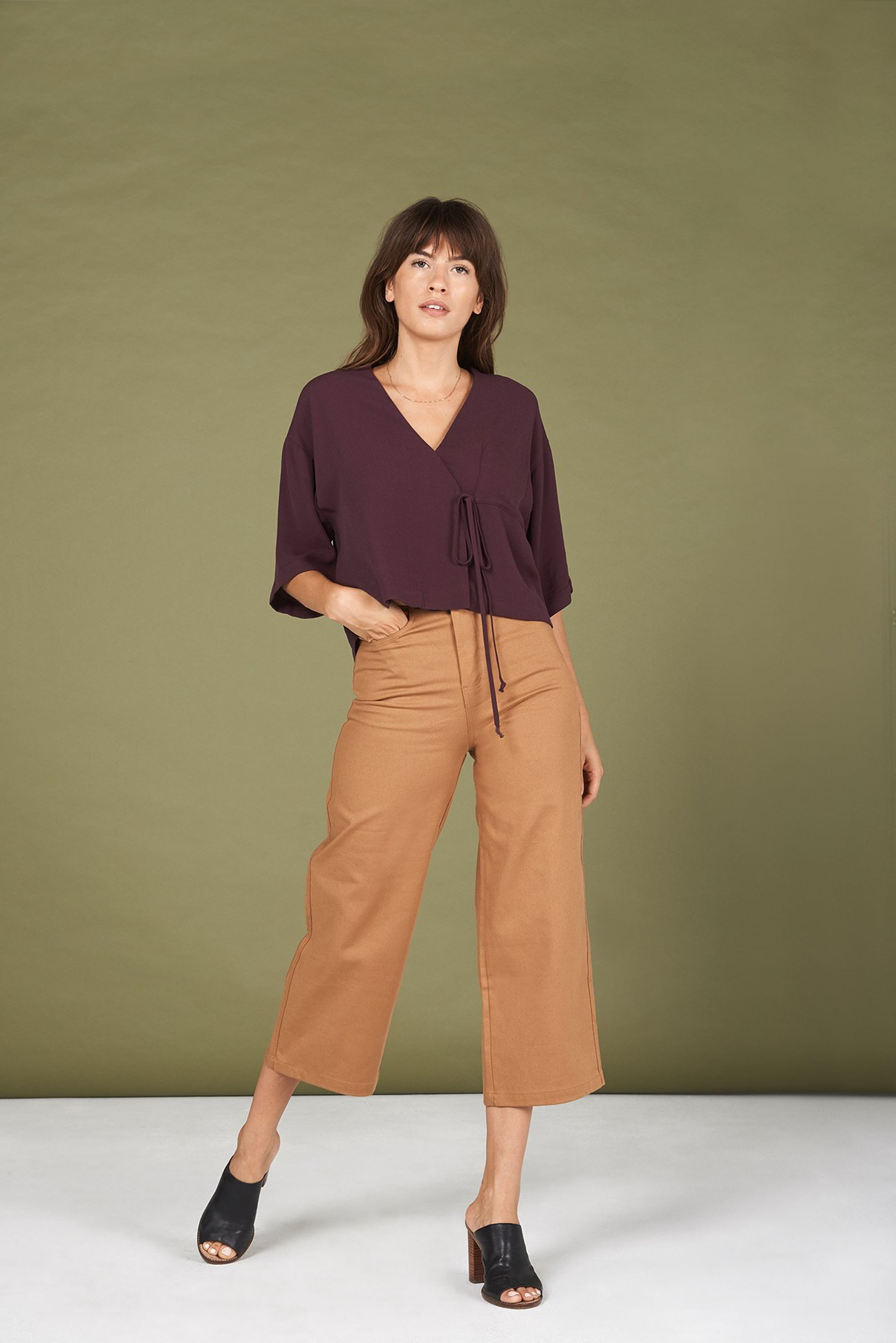 Whimsy & Row - Taylr Top / $72With its cool mornings and scorching afternoons, it's hard to plan an outfit that accommodates autumn's fickle behavior. That's why this breathable, rayon wrap-top will be a perfect accomplice to any cardigan.