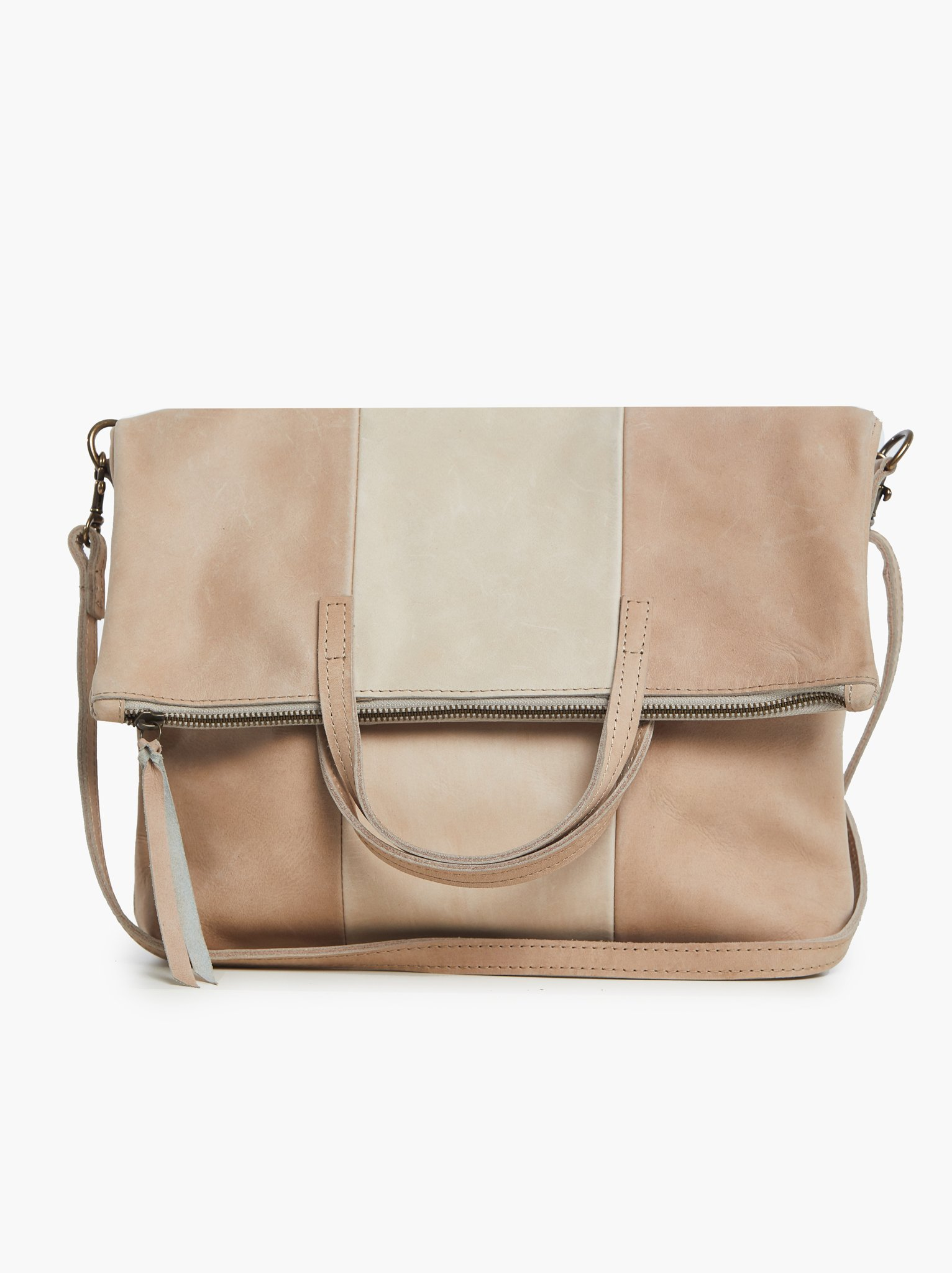 able - Emnet Foldover Tote in Fog/Bone / $198This folder tote is ethically made from ethically sourced leather and suede and provides a fair paying job to a woman in Ethiopia - oh and also it's the most delicious color ever. So many fantastic reasons to rock this bag.