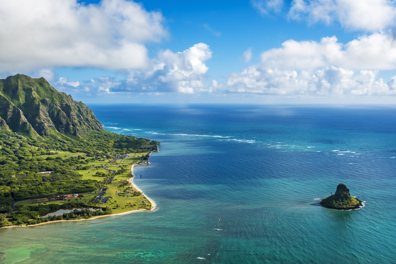 Part of the island of Oahu, which was formed from volcanic activity rather than the buildup of coral consistent with the formation of cayes.
