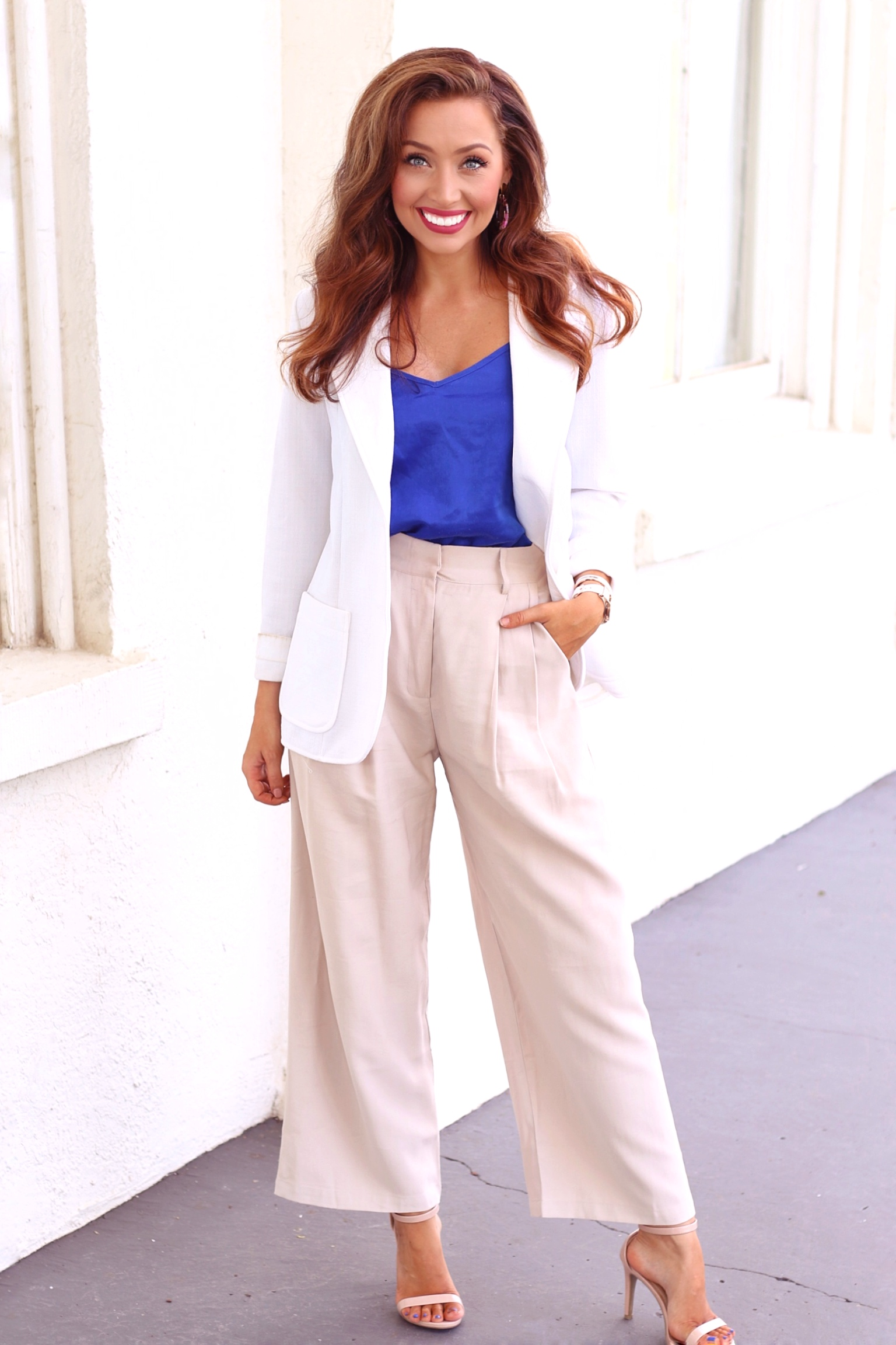 A silk camisole and a sharp blazer tie this look together for the ultimate professional uniform. Some power pumps kick it up a notch even more. This has to be my favorite!