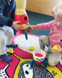 Problem Solving / Play   We focus on early constructive play and support your child showing an interest in  - toys and their function  - using toys for their intended purpose (i.e. putting objects in containers)  - experimenting with how things work  - demonstrating problem solving skills when engaging with toys