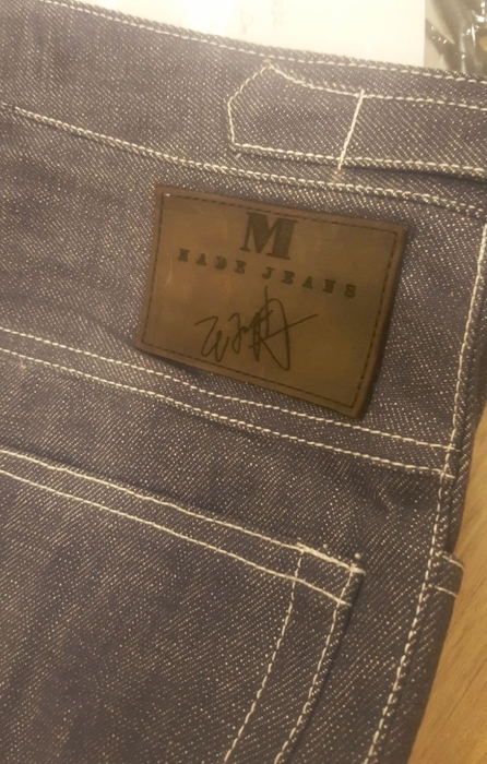ONE OF OUR CLIENT'S SIGNATURE AT THE BACK OF HIS DENIM JEANS.