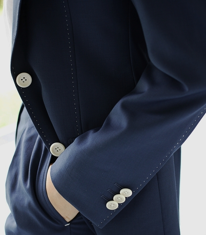 SIGNATURE CLAW STITCHING USING NATURAL  COROZO  BUTTONS.