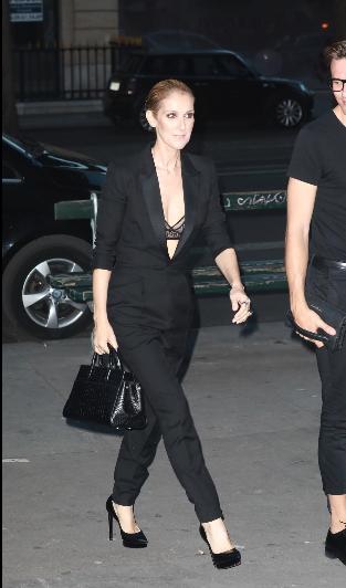 Celine Dion wore a black suit without a shirt underneath.
