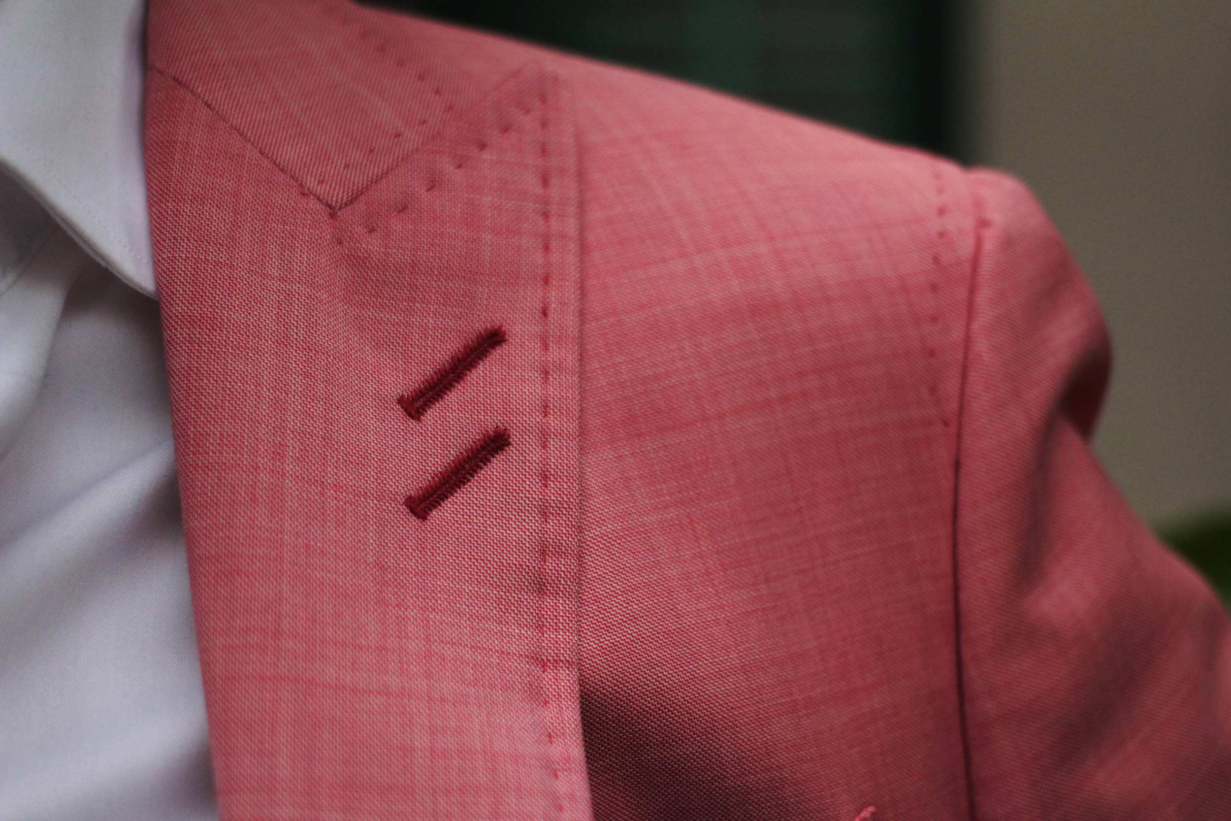 SPECIALLY MADE Double Lapel ButtonsHoles for a more upbeat look.
