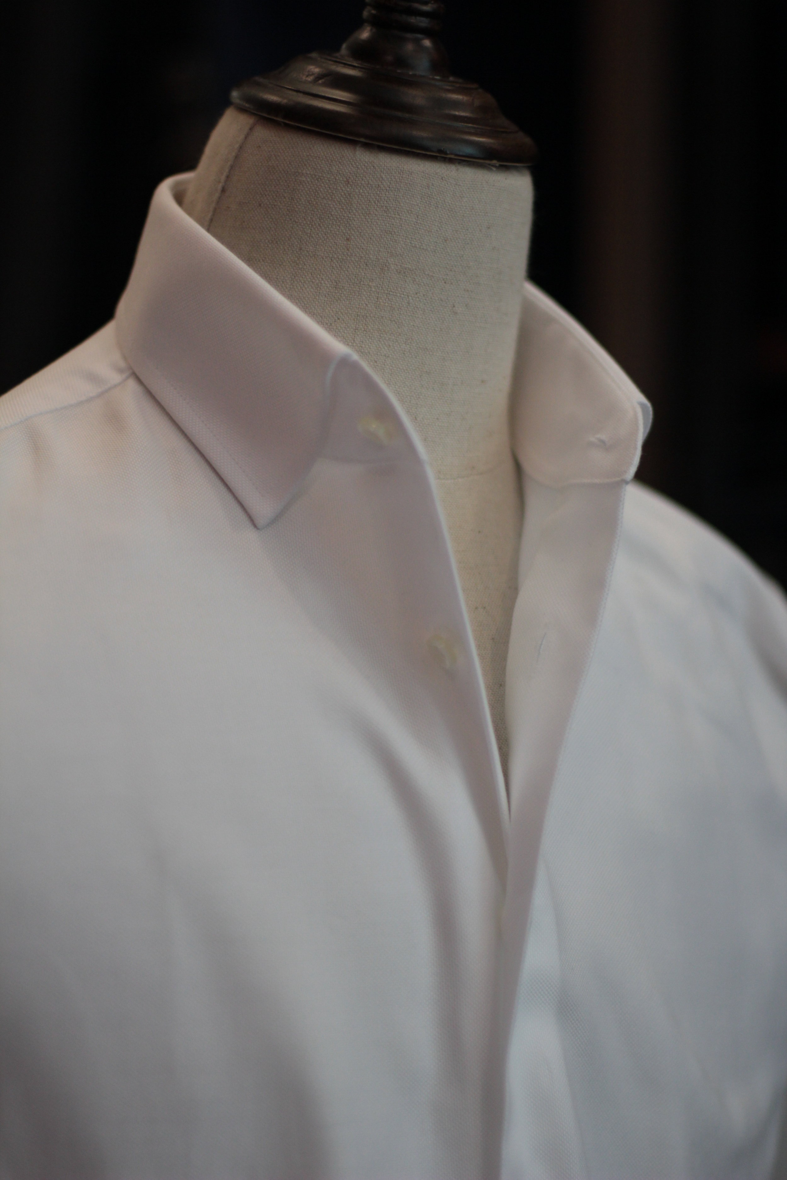 Canvassing our shirt plackets , Our Collar stands up well