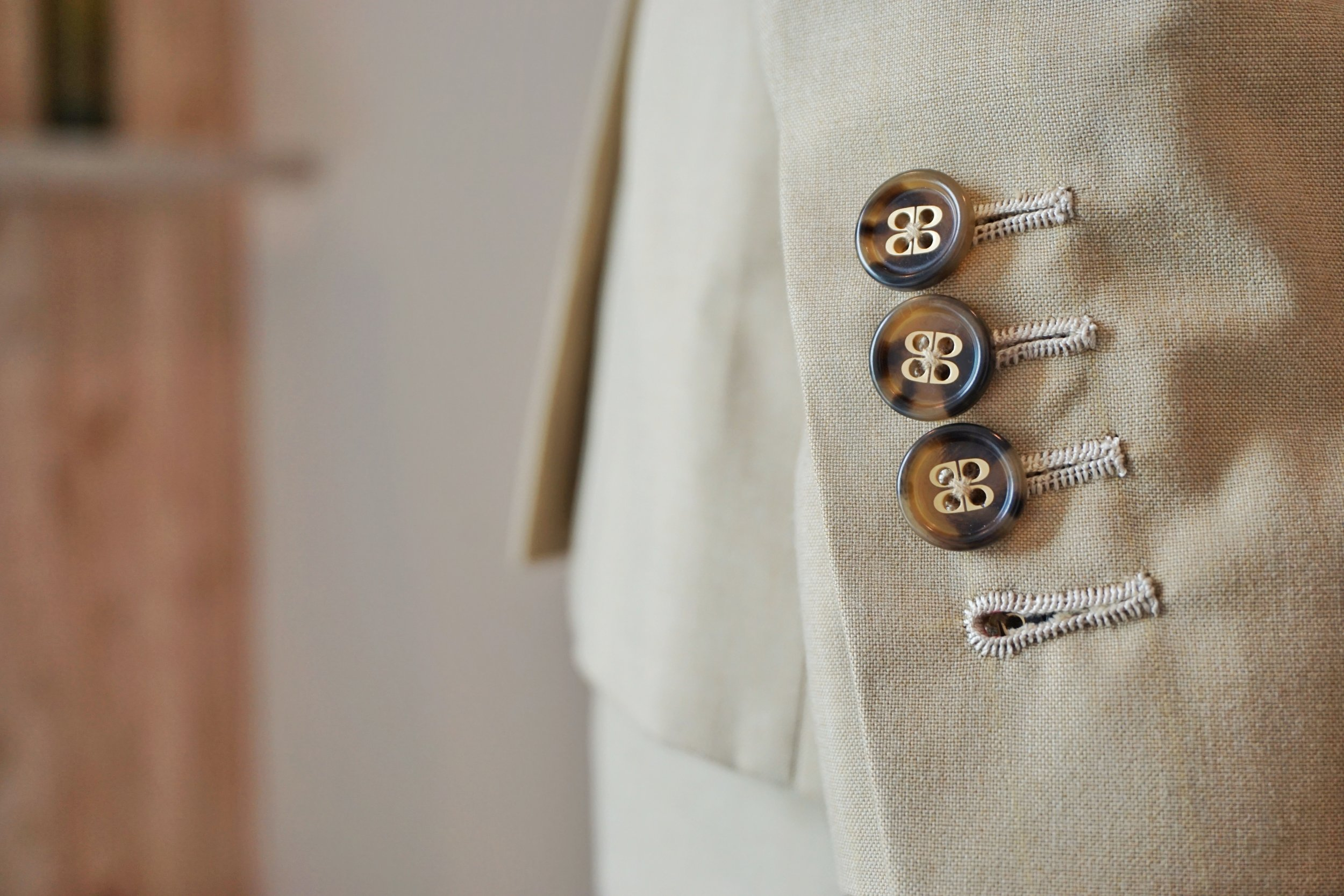 Functional Sleeve buttons with handmade stitching.