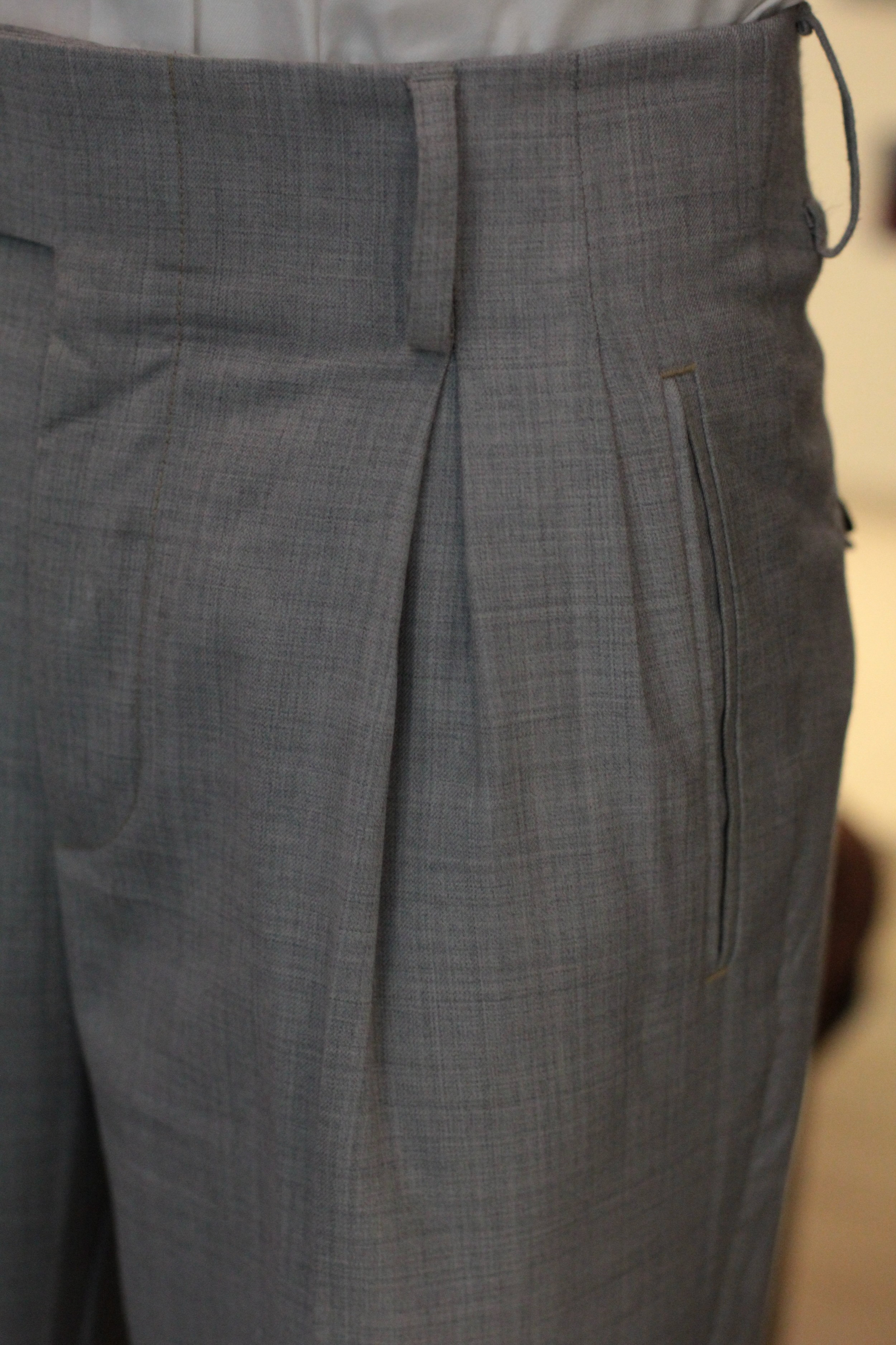 Vertical Pockets with yellow stitching.