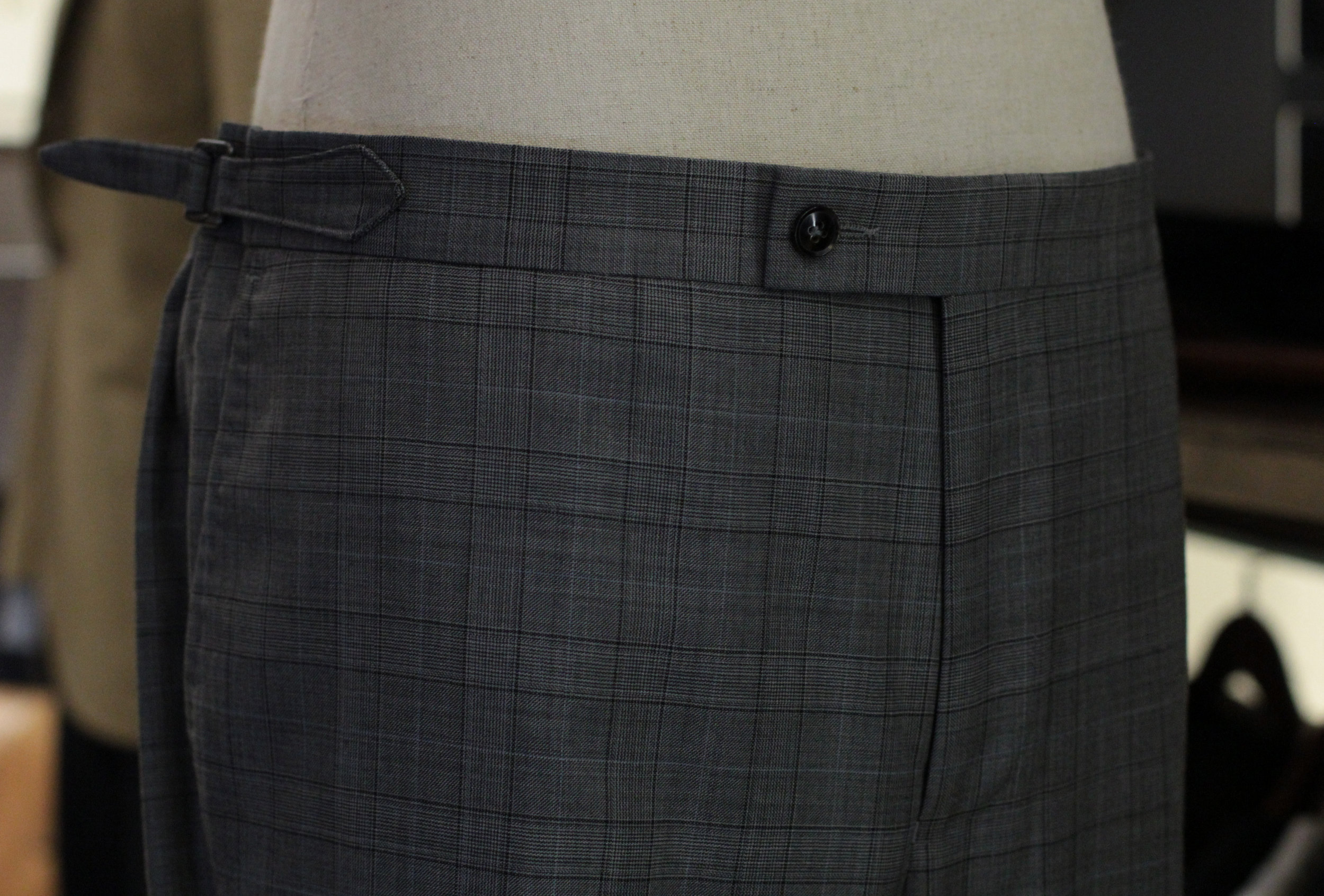 Grey Prince Of Wales Super 130s Bespoke Trousers Made to measure trousers side adjusters front.JPG