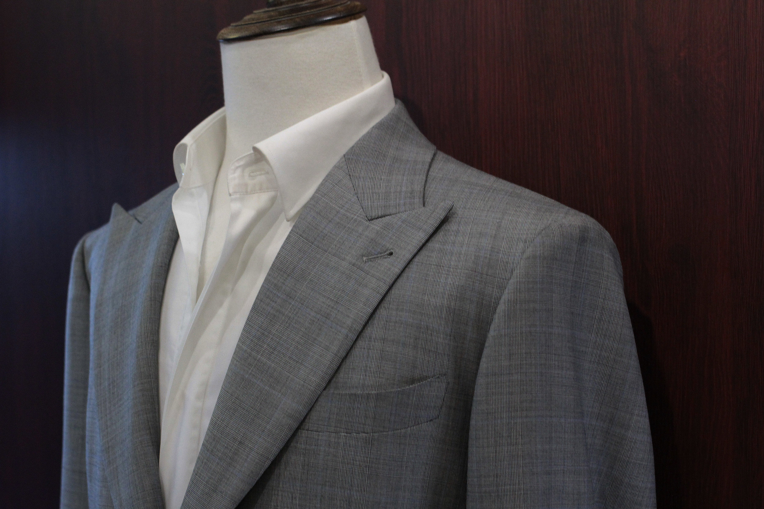 The Novelty Grey Filarte Glen checks prince of wales grey made suits made to measure bespoke suits label front.JPG
