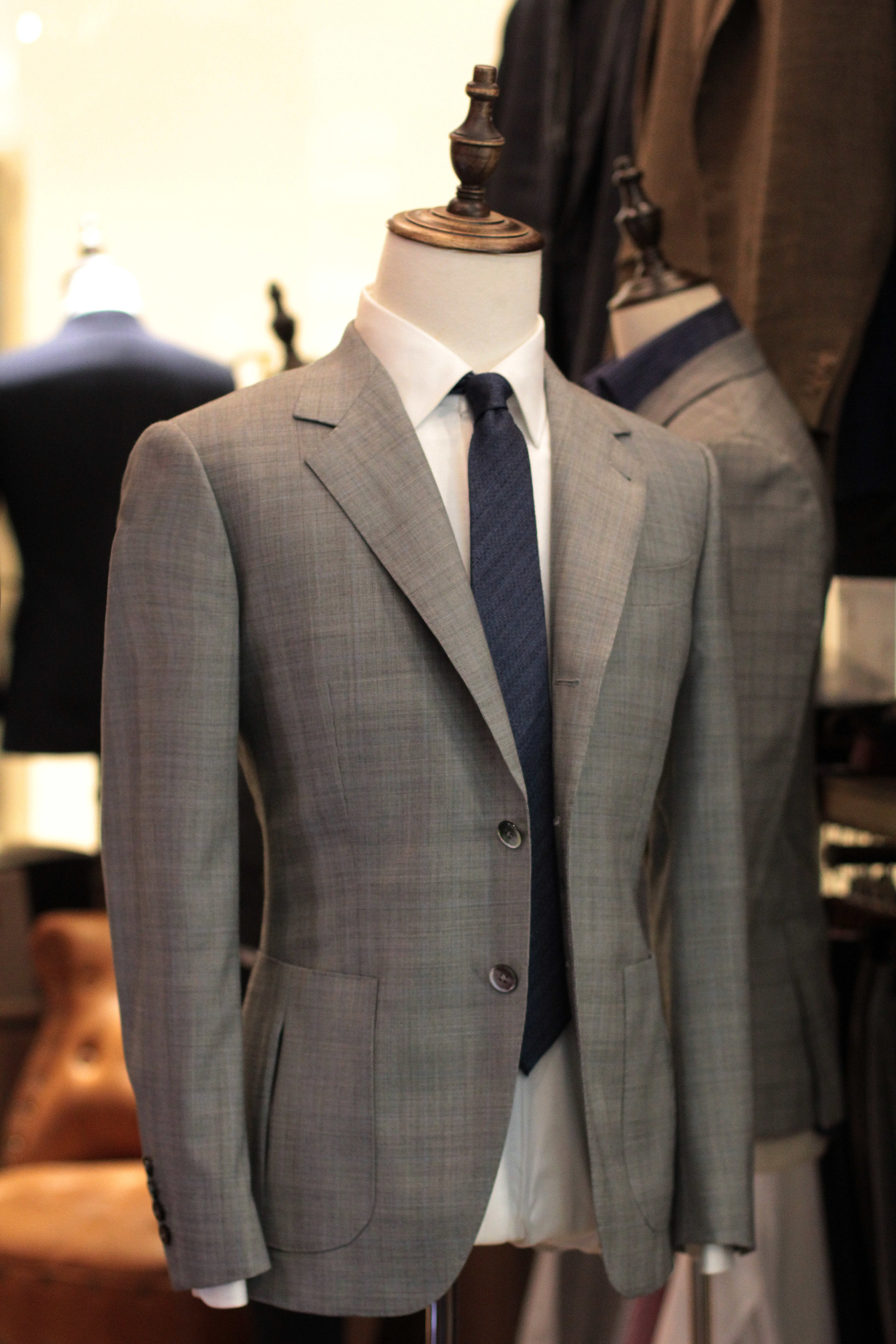 The Novelty Grey Filarte Glen checks prince of wales grey made suits made to measure bespoke suits side.JPG