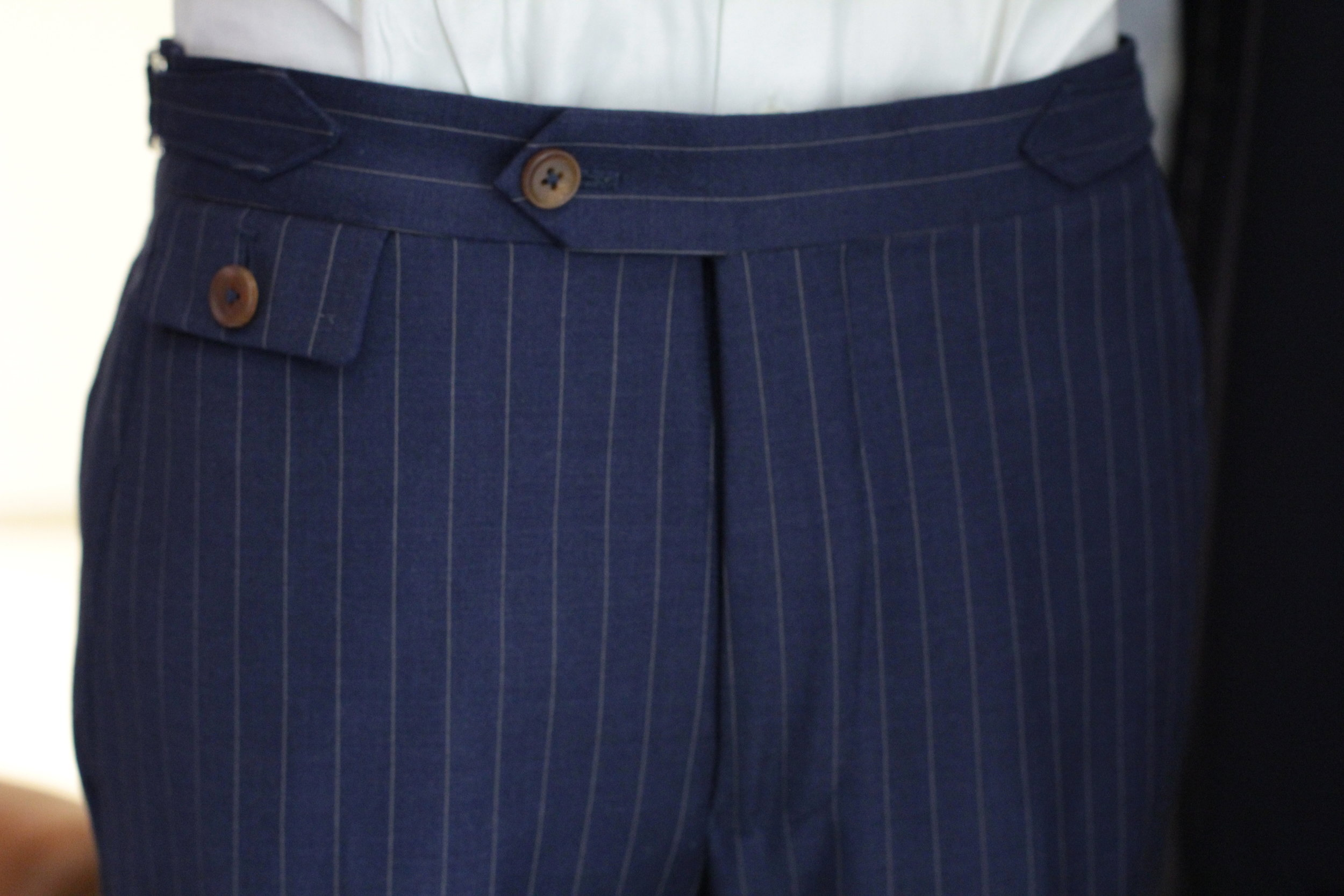 Extended tab and zip fly with  SIDE ADJUSTERS  for a look of Vintage yet Elegant.