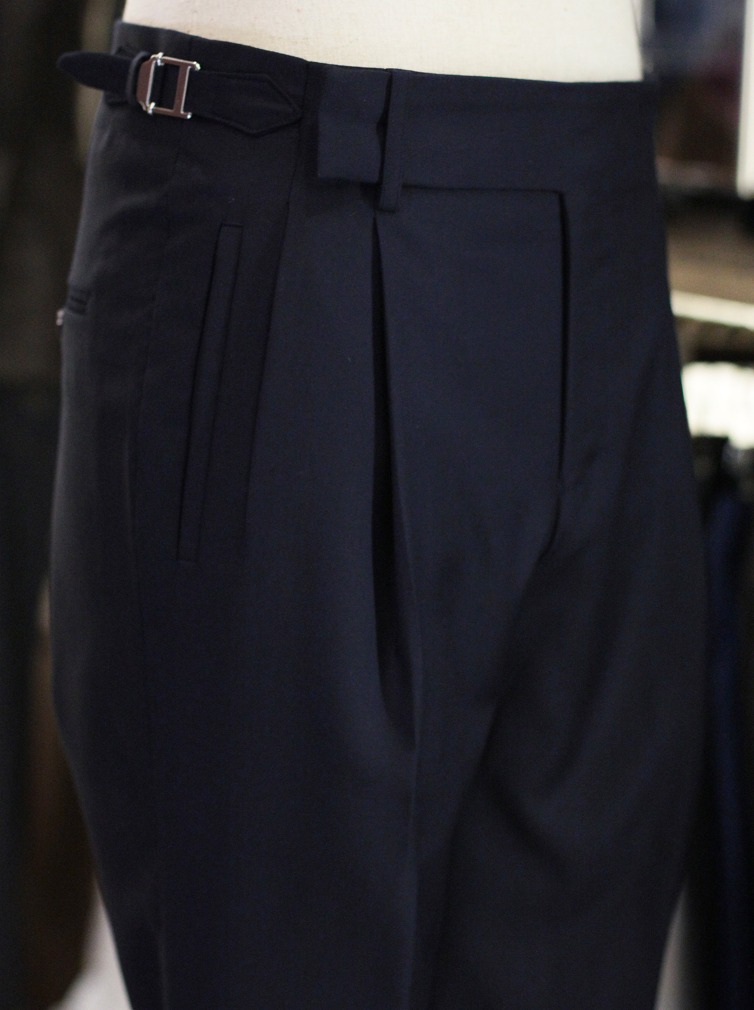 Single Pleated Front with One Piece Waistband Style.