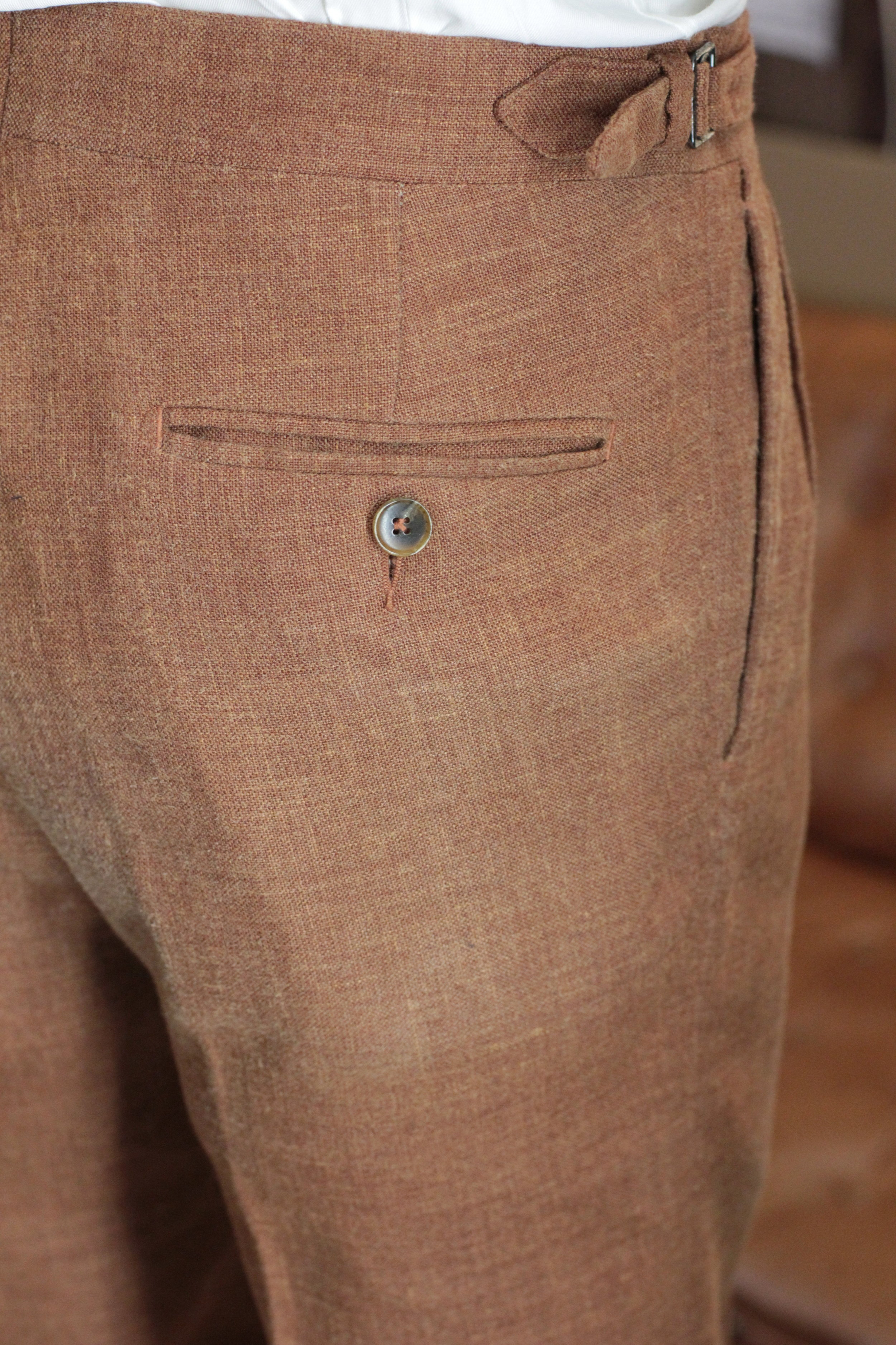 Back Pocket with Horn Button.