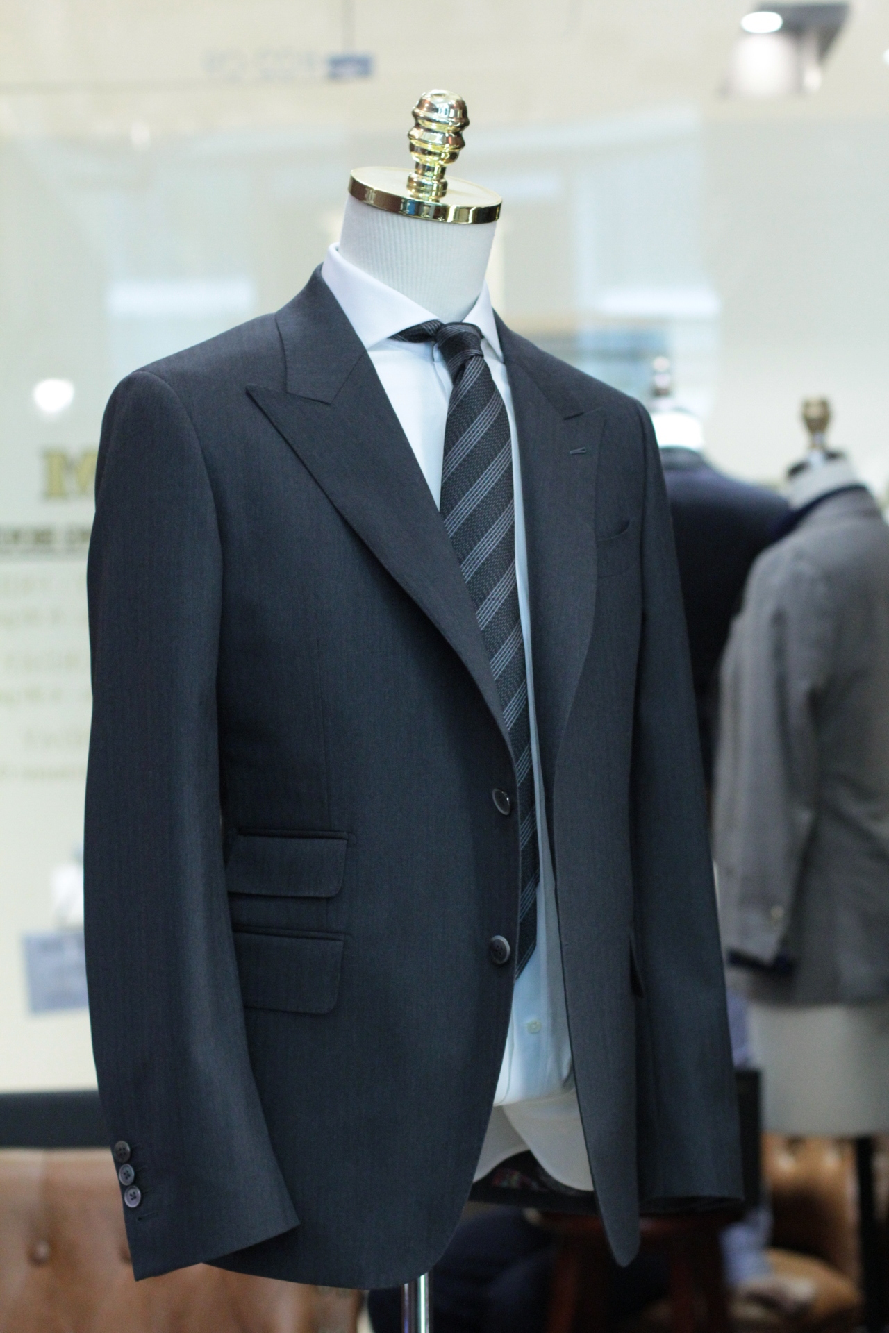 The Teller MADE SUITS Guabello Grey Herringbone Suits | Tailor Made Suits Singapore