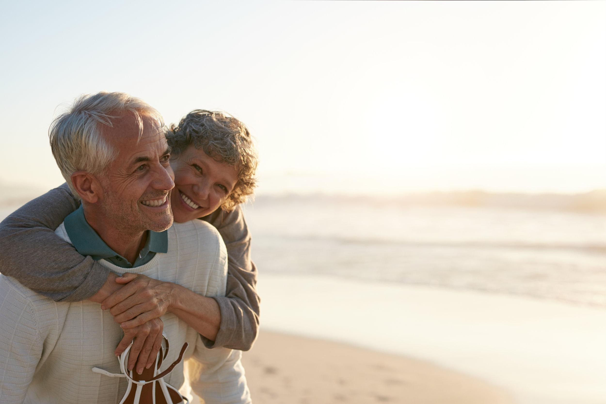 Senior couple having fun at beach.jpeg