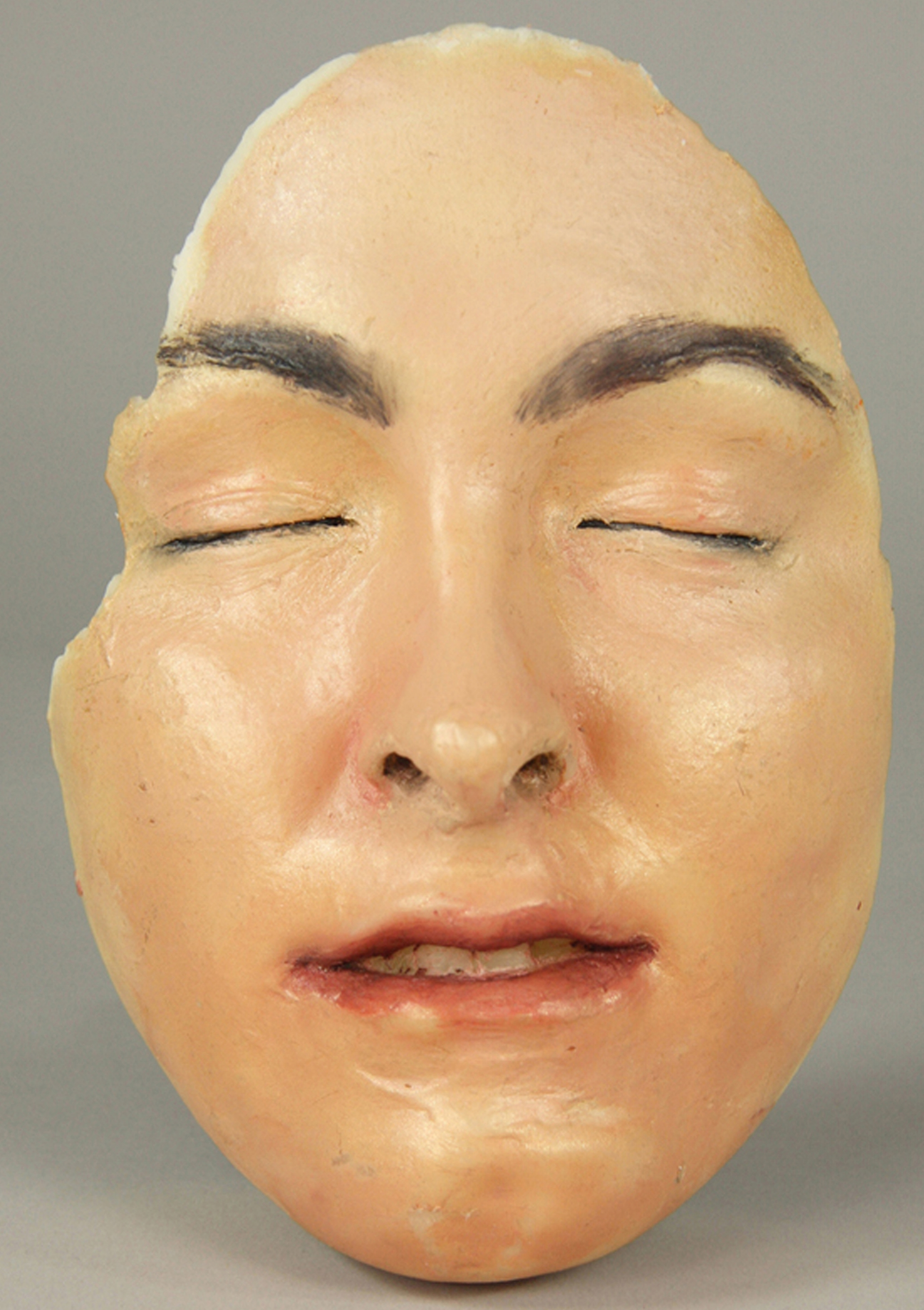 "10. Mask of K. McGrath. Cast wax, oil paint, 8 ¼ ""x 6"" x 4"", 2011..jpg"