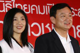 AsiaSociety: From left, Thai Prime Minister Yingluck Shinawatra, and her brother, former prime minister (2001-2006), Thaksin Shinawatra, who was charged with corruption in 2008.
