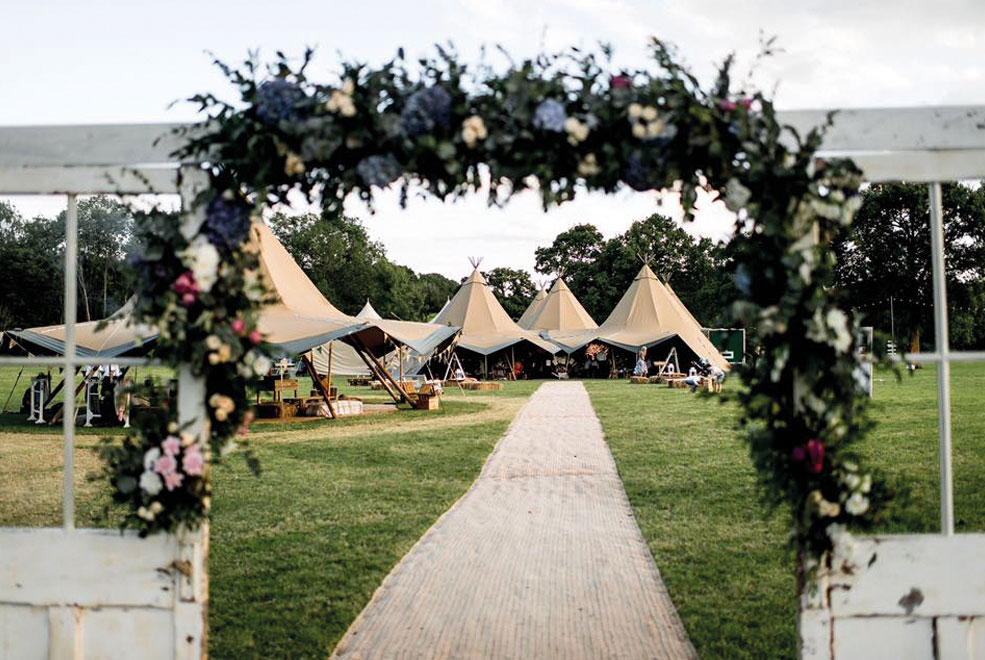 Large-Wedding_Teepees_Giant-Hat_Kung_Flower-Arch_Summer.jpg
