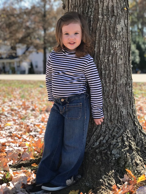 Here my tiny root is wearing a black and white stripe GAP turtleneck and a pair of 1969 GAP high waist sailor jeans. This outfit set me back $12 and came new with tags.