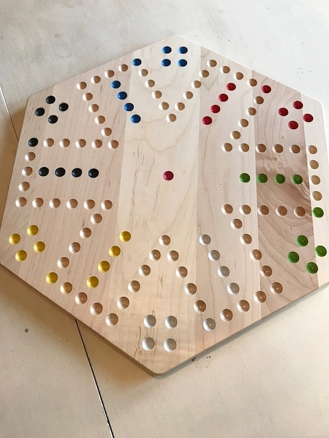 The beautiful Maple wood Aggravation board by Amish Toy Box