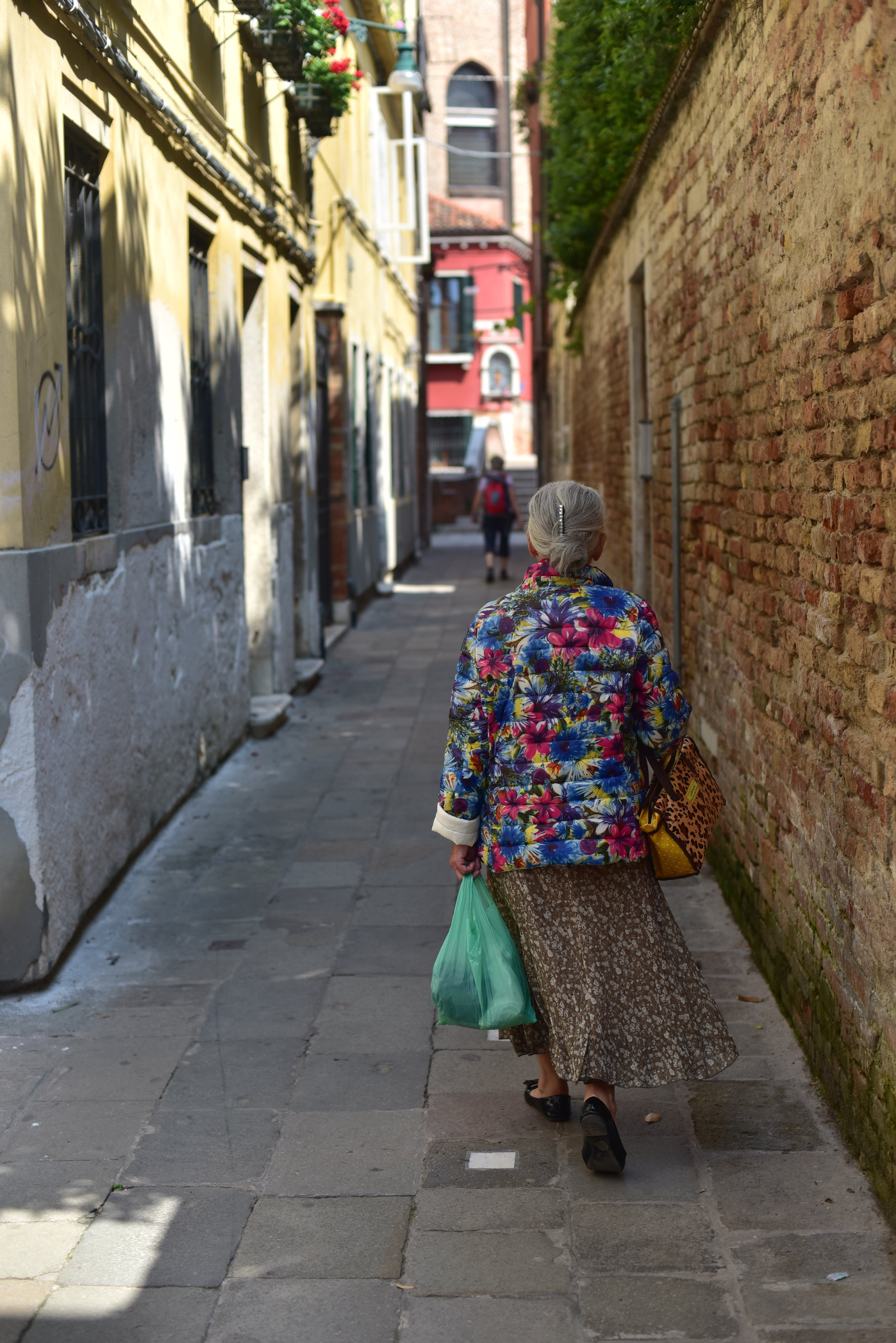 A colorful lady in an alle, Venice, Italy