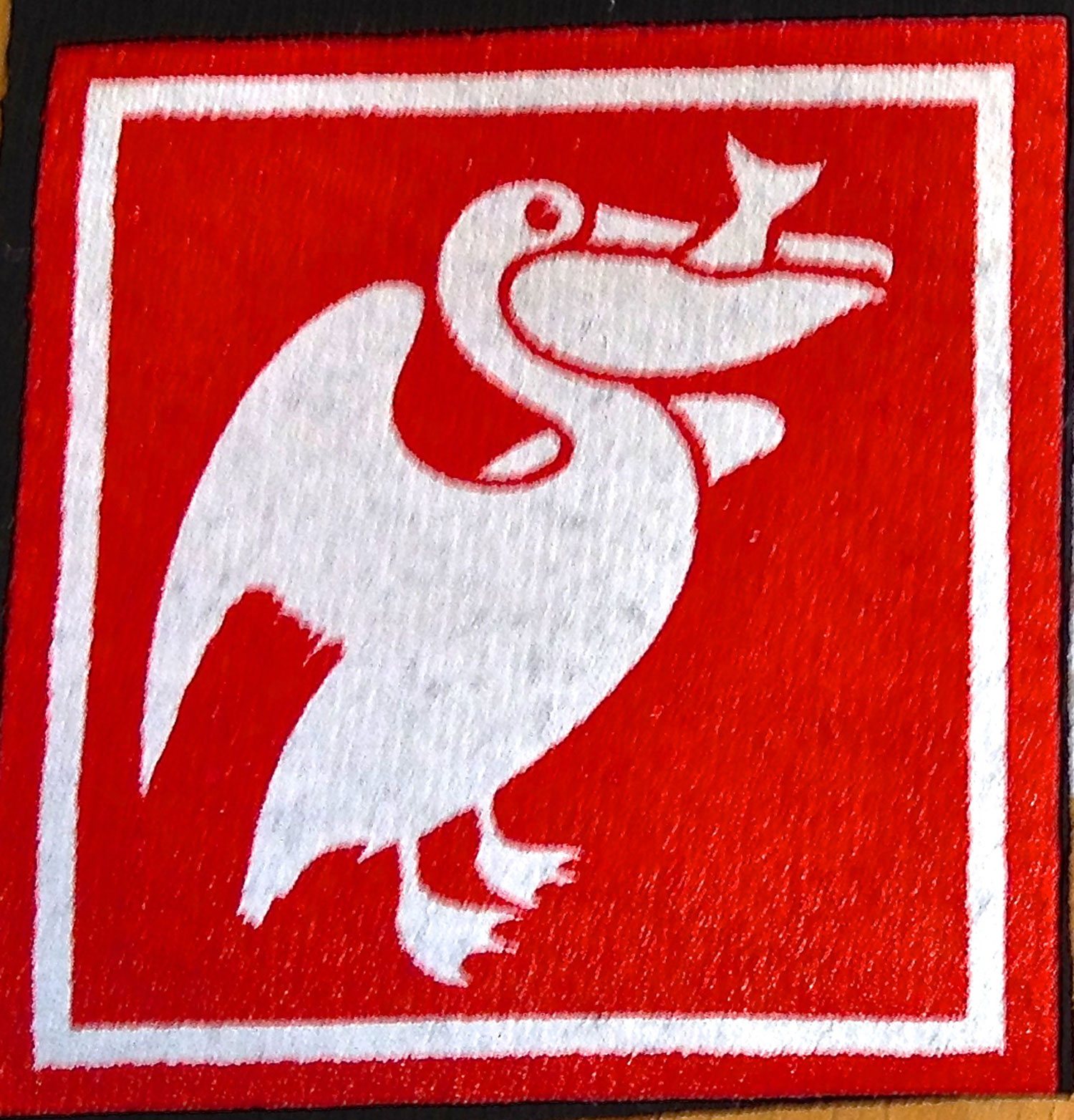 The red in the pelican print has 2 layers of white under it