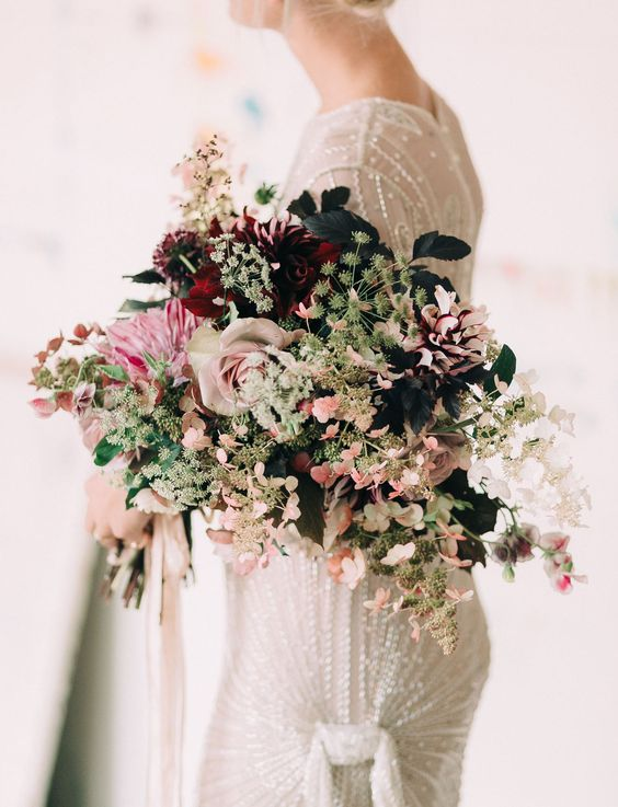 Photo by  Emily Delamater , via  Green Wedding Shoes