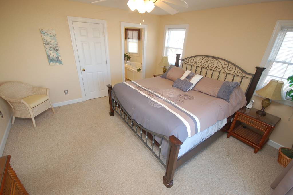 Another Angle of Main Level King Master Suite with Private Deck and Jacuzzi Tub.jpg