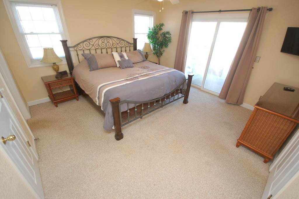 Main Level King Master Suite with Private Deck and Jacuzzi Tub.jpg