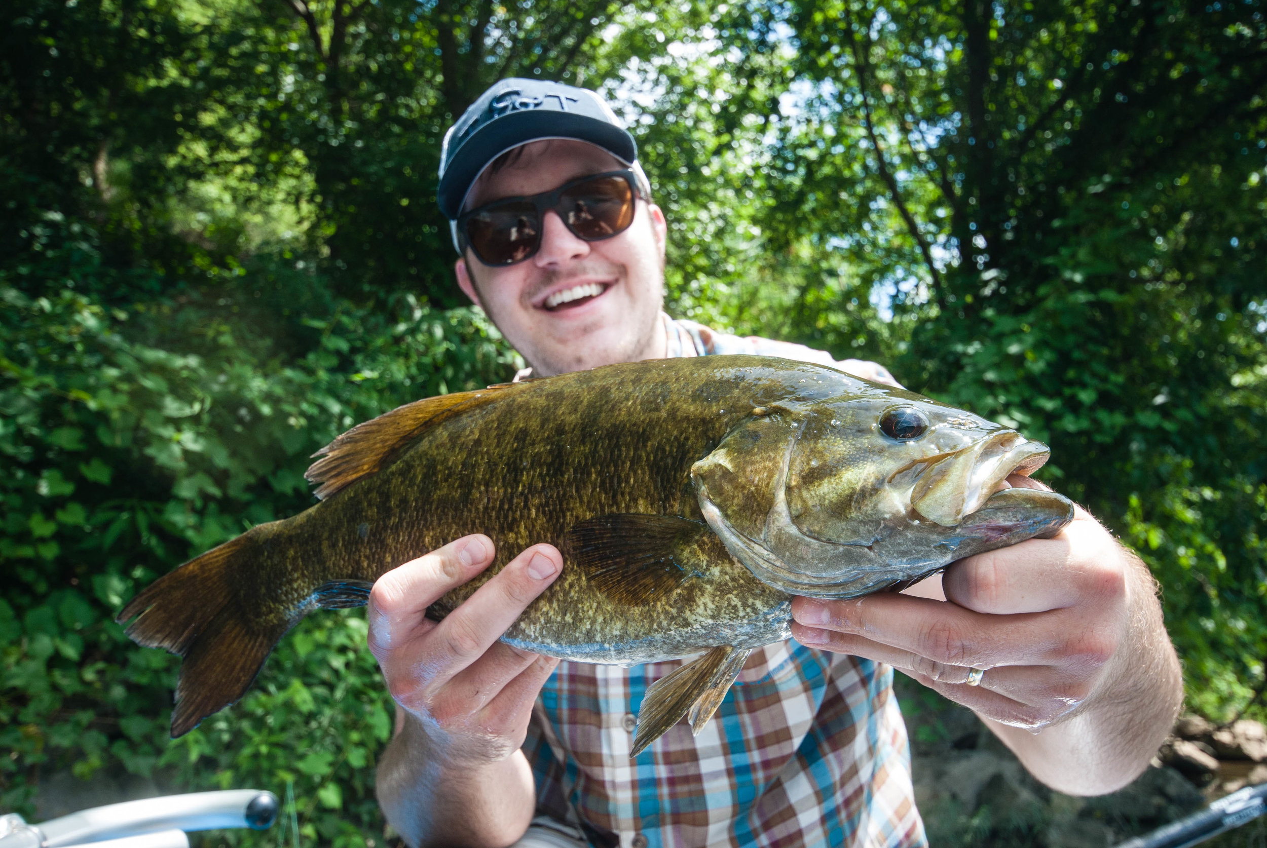 "Ethan Martin with a near 21"" Virginia smallmouth caught on a popper!"
