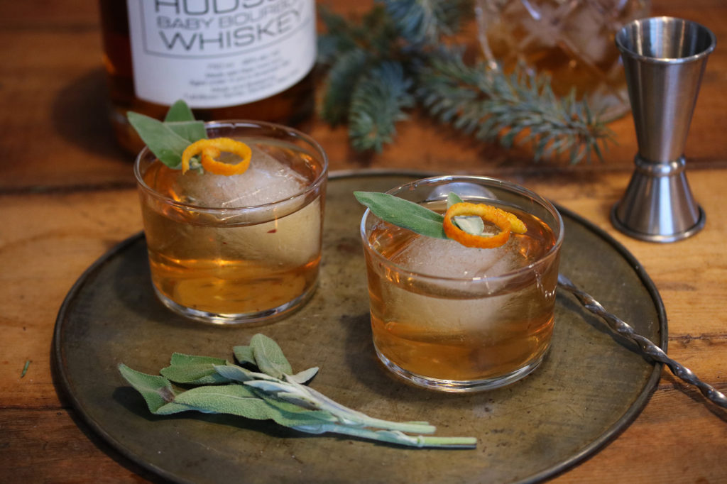 Sage Honey Bourbon Cocktail - Sage Honey Syrup1 cup water1/2 cup honey10-12 fresh sage leavesCocktail2 ounces bourbon1 orange peel1 fresh sage leaves3 tbsp honey sage syrupInstructions1. Bring the water, honey, and sage to a boil in a pot over medium high heat. Reduce to low and simmer 3 minutes. Turn off heat and let syrup cool. It will thicken once cooled.2. Fill your Old Fashioned Glasses with ice. Pour bourbon and cooled syrup over ice. Twist your orange peel directly over glass until you see the oils release. Place in glass with bourbon and garnish with a fresh sage leaf.3. You can adjust the sweetness of this drink with additional sage honey syrup.