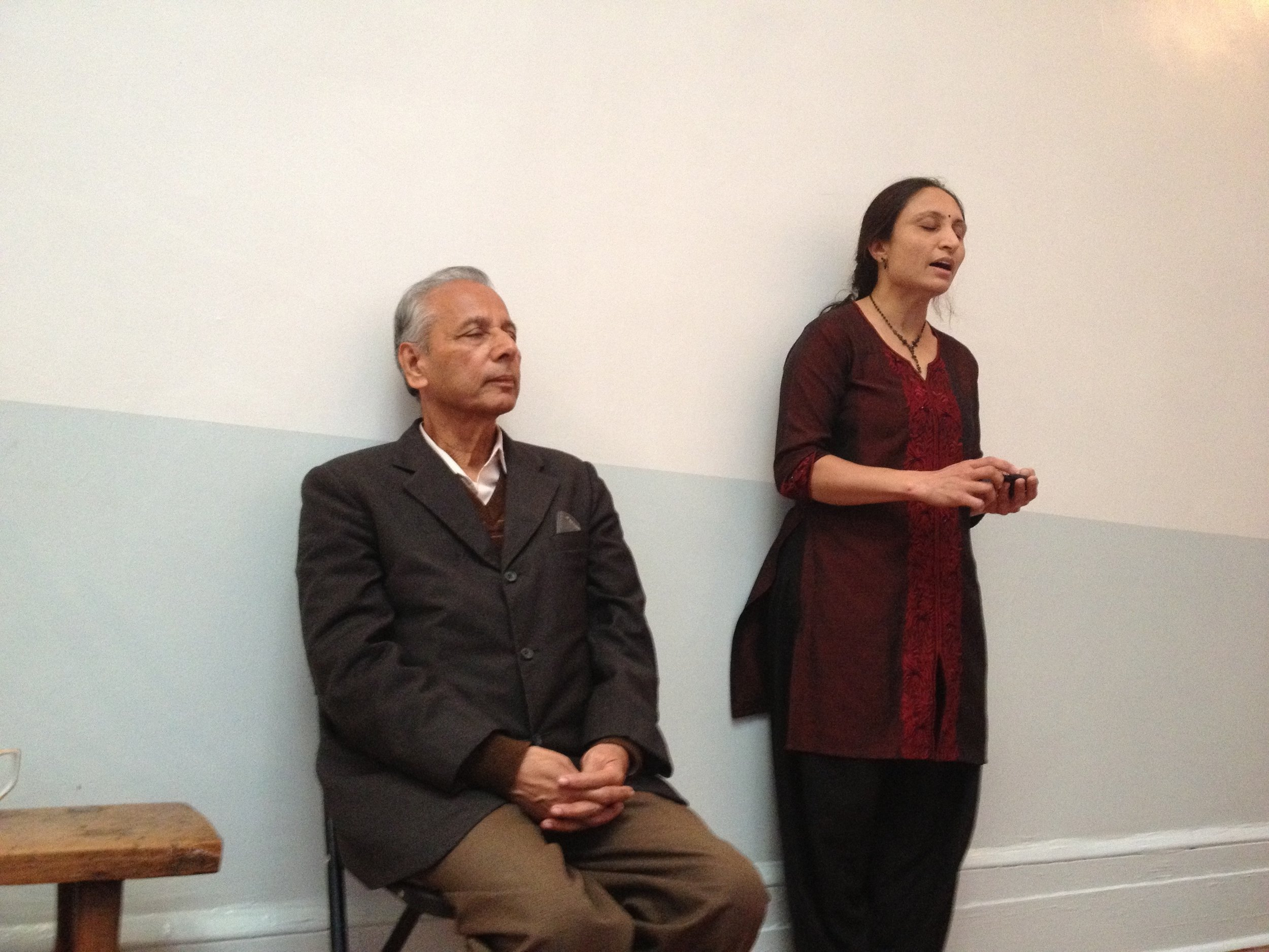Professor H.V. Rao listening while his daughter sings.